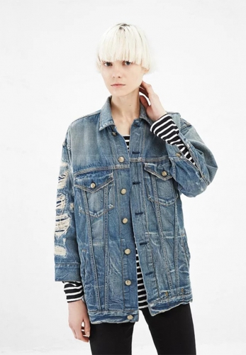 Worn long sleeved denim jacket